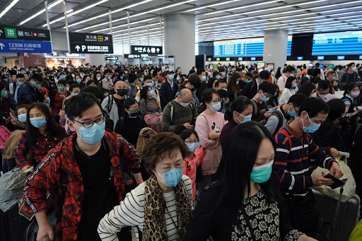 Passengers wearing protective face masks